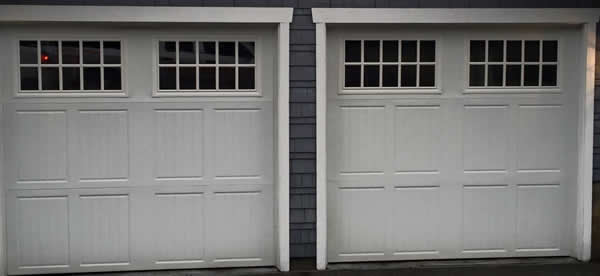 Two New White Garage Doors Installed By The Doorhouse