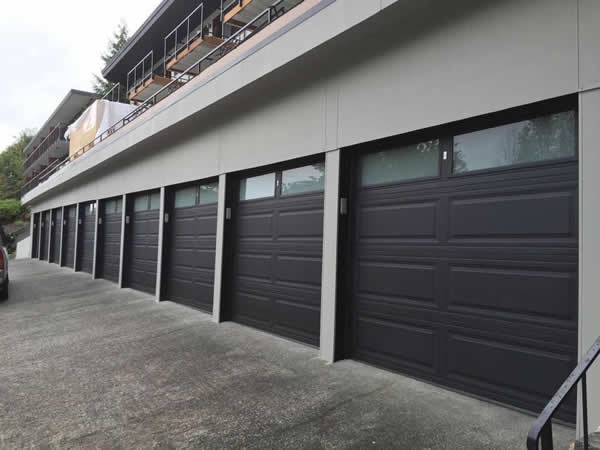 Apartment building garages with new doors installed by The Doorhouse