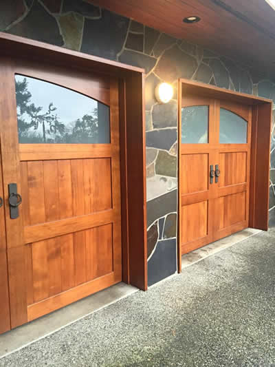 Twin wood carriage style garage doors installed by The Doorhouse