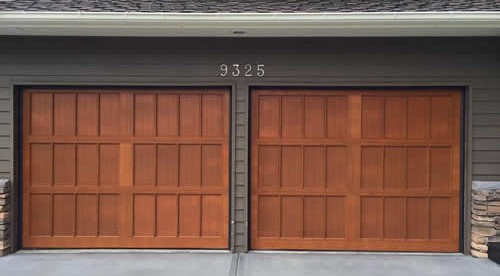 Wood paneled garage doors installed by The Doorhouse